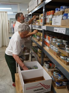 Two Volunteers sort food for Newberg FISH