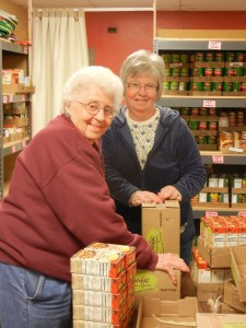 Two Newberg FISH Volunteers sorting food